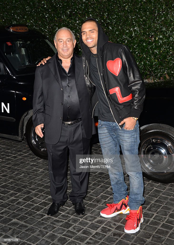 Proprietor Sir Philip Green (L) and singer Chris Brown arrive at the Topshop Topman LA Opening Party at Cecconi's West Hollywood on February 13, 2013 in Los Angeles, California.