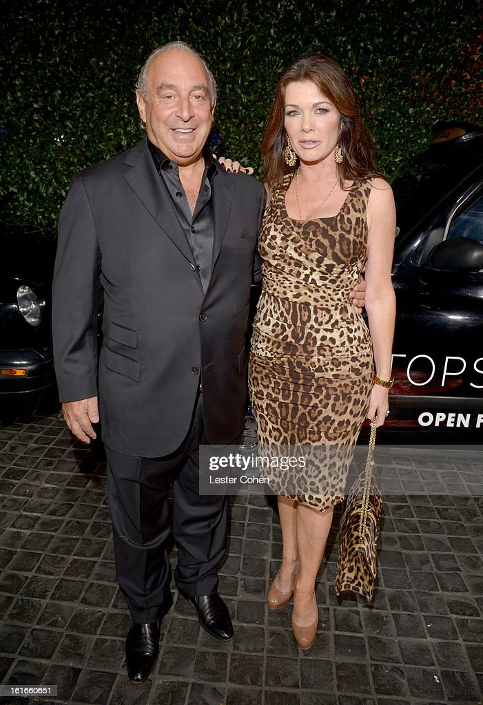 Proprietor Sir Philip Green (L) and TV personality Lisa Vanderpump arrive at the Topshop Topman LA Opening Party at Cecconi's West Hollywood on February 13, 2013 in Los Angeles, California.