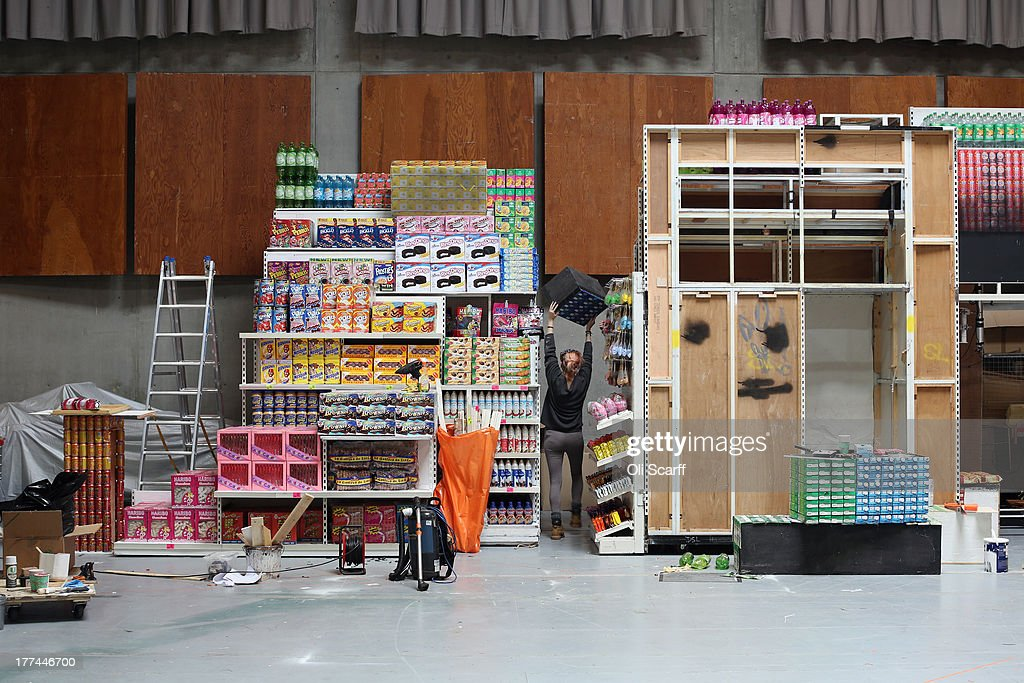 Props makers work on the set of a production of 'Hansel and Gretel', set in a supermarket, at Glyndebourne opera house on August 22, 21013 in Lewes, England. The Glyndebourne Festival of six operas performed at the East Sussex opera house from May until August sees its final performance of the season on August 25, 2013. The Glyndebourne opera house stands in the grounds of the country home of John Christie, who founded it in 1934, today it is recognised globally as one of the world's great opera houses.