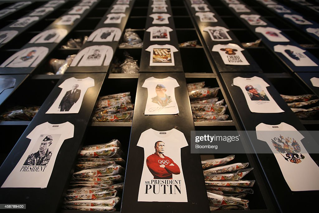 ProPutin tshirt designs sit on a display wall inside an Alexander Konasov clothing store promoting their Patriot collection of patriotic Russian...