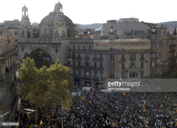 Proreferendum demonstrators gather during a protest near the Economy headquarters of Catalonia's regional government in Barcelona on September 20...