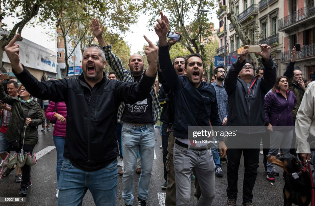 Pro-Referendum supporters clash with members of the Spanish National Police, after police tried to enter a polling station to retreive ballot boxes during today's referendum vote on October 1, 2017 in Barcelona, Spain. More than five million eligible Catalan voters are estimated to visit 2,315 polling stations today for Catalonia's referendum on independence from Spain. The Spanish government in Madrid has declared the vote illegal and undemocratic.