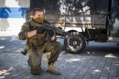 A proRussia rebel guards a checkpoint close to the central railway station on July 21 2014 in Donetsk Ukraine Local authorities warned residents in...