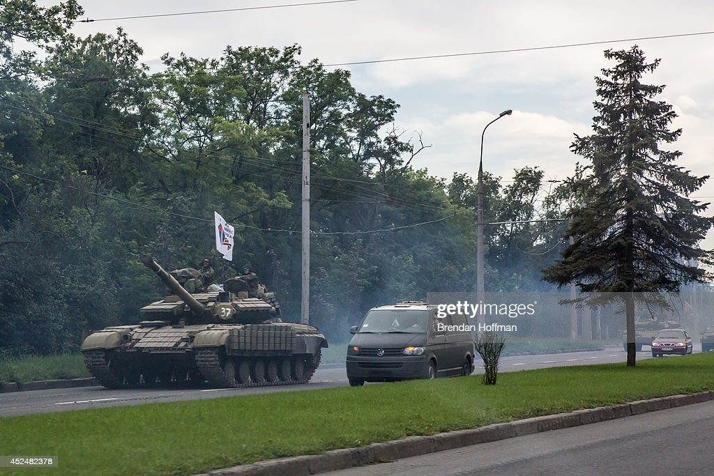 Pro-Russia rebels travel in a convoy of tanks and transport vehicles as fighting escalates in the city following the crash of Malaysia Airlines flight MH17 on July 21, 2014 in Donetsk, Ukraine. Malaysia Airlines flight MH17 was travelling from Amsterdam to Kuala Lumpur when it crashed killing all 298 on board including 80 children. The aircraft was allegedly shot down by a missile and investigations continue over the perpetrators of the attack.