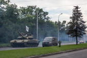 ProRussia rebels travel in a convoy of tanks and transport vehicles as fighting escalates in the city following the crash of Malaysia Airlines flight...