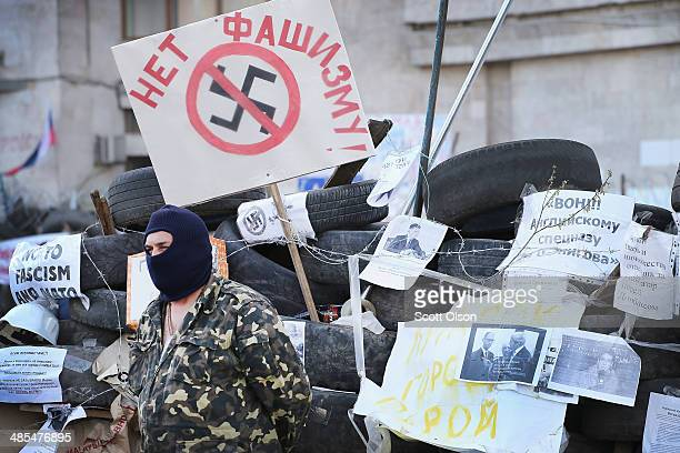A proRussian activist guards the front of the Donetsk Regional Administration building on April 18 2014 in Donetsk Ukraine The group of activists who...