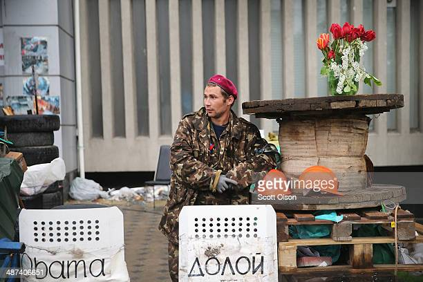 A proRussian activist stands guard outside the security services building on April 30 2014 in Lugansk Ukraine The area around the security services...