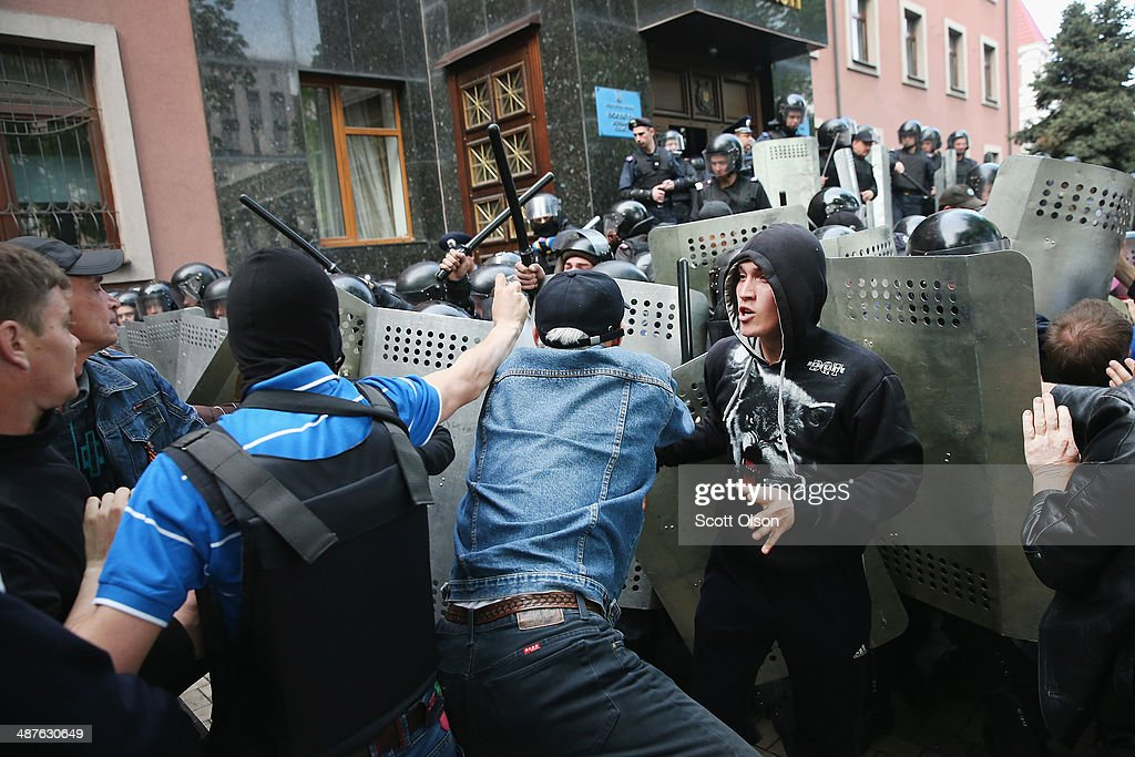 ProRussian activists clash with police in front of the prosecutors office on May 1 2014 in Donetsk Ukraine As many as 1000 activists marched to the...