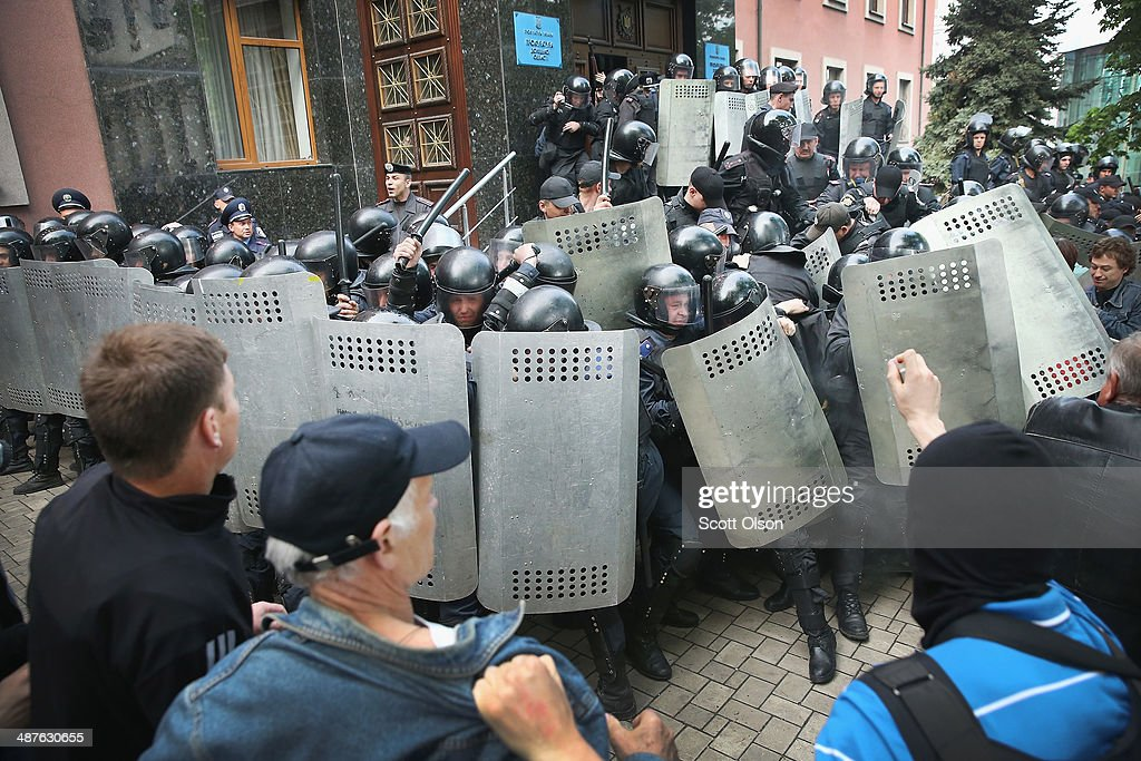 Pro-Russian activists clash with police in front of the prosecutors office on May 1, 2014 in Donetsk, Ukraine. As many as 1,000 activists marched to the prosecutors and overran the police who were guarding the building. They took control of the building and confiscated riot gear from the police before setting the officers free.