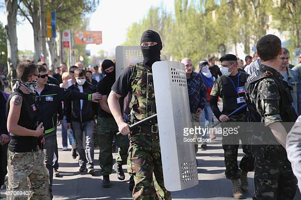 ProRussian activists prepare to break through the gate in front of TRK Donbass television station on April 27 2014 in Donetsk Ukraine A group of...