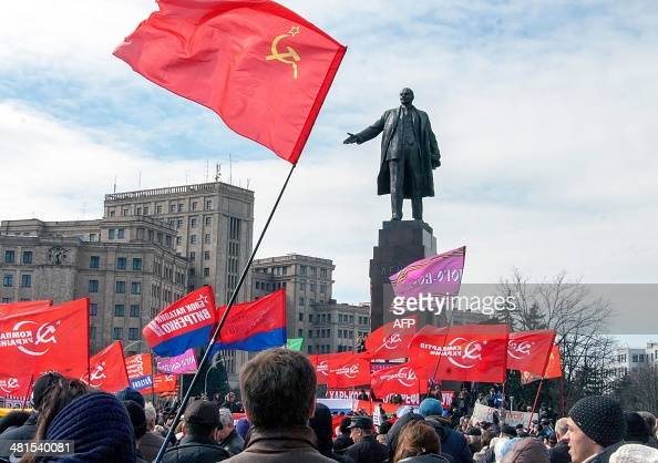 ProRussian activists rally in front of the Lenin monument in Kharkiv on March 30 2014 US Secretary of State John Kerry met his Russian counterpart...