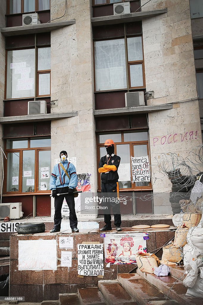 Pro-Russian activists stand guard outside of the Donetsk Regional Administration building on April 19, 2014 in Donetsk, Ukraine. The group of activists who are occupying the building have surrounded it with a barricade of tires and barbed wire and are prepared to defend it with caches of Molotov cocktails strategically placed within the barricade. Activist leader, Denis Pushilin, who is co-head of the self-declared Donetsk People's Republic, said yesterday that they will not surrender until there is a change of leadership in Ukraine. Several bands of separatists, similar to those in Donetsk, have been occupying government buildings in other eastern Ukraine cities in recent weeks