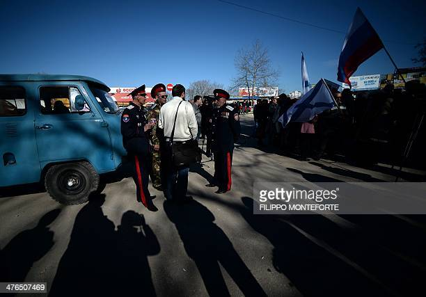 ProRussian demonstrators gather outside the headquarters of the Ukrainian Navy in Sevastopol on March 3 2014 Russian forces have given Ukrainian...