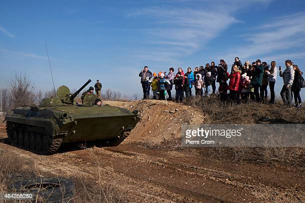 ProRussian Donetsk residents watch a tank display as people celebrate the Russian festival 'Defender of the Fatherland' day on February 23 2015 in...