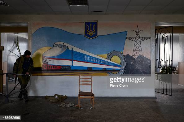 A proRussian fighter stands guard in the town's train station on February 20 2015 in Debaltseve Ukraine The strategic railway town of Debaltseve is...