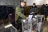 A proRussian militant casts his ballot during voting in Novoazovsk Donetsk region on November 2 2014 ProRussian separatists in eastern Ukraine began...