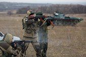 ProRussian militants fire their Kalachnikov asssault rifles near an tank taken from Ukrainian forces during fighting in August as they test fire in...