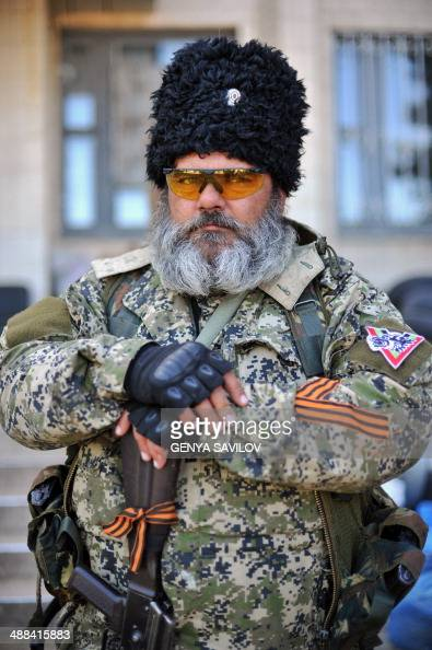 A proRussian militants holds a Kalashnikov as he guards a barricade outside the city hall in downtown Kramatorsk eastern Ukraine on May 6 a day after...