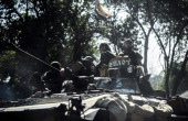 ProRussian militants sit on a tank on July 27 2014 in Donetsk eastern Ukraine as they drive to the front line south of the city Dutch and Australian...