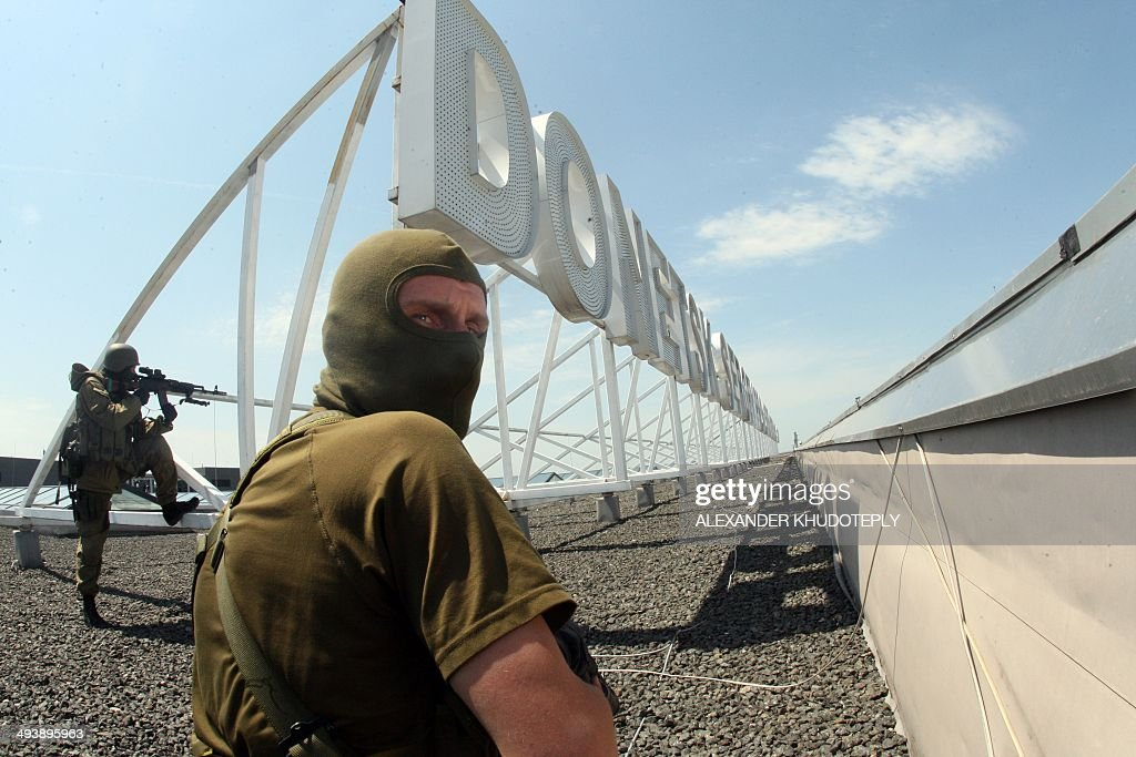 ProRussian militants take position on the roof of the international airport of the eastern Ukrainian city of Donetsk on May 26 2014 The main airport...
