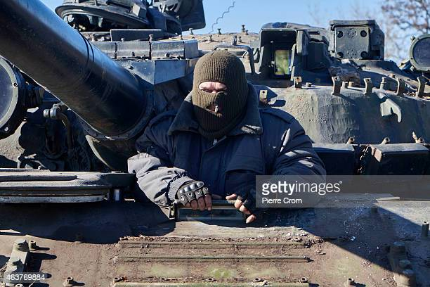 A proRussian rebel smokes on a tank near Debaltseve on February 18 near Vuglegirsk Ukraine Ukrainian troops have been forced to retreat from...
