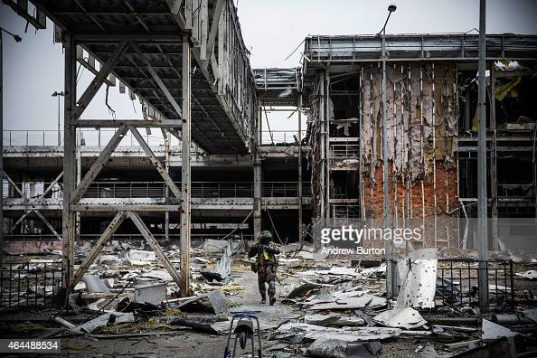 A proRussian rebel walks amongst the wreckage of the destroyed Donetsk airport on February 26 2015 in Donetsk Ukraine The Donetsk airport has been...
