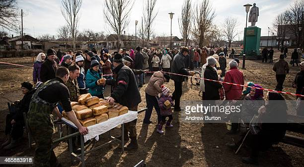 ProRussian rebels hand out freshly baked bread to civilians as humanitarian aid on March 11 2015 in Chornukyne Ukraine Chornukyne a small village...