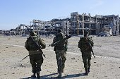 ProRussian rebels sappers walk toward the destroyed Donetsk international airport on October 13 2015 Ukrainian forces lost control of the airport in...