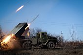 ProRussian rebels stationed in the eastern Ukrainian city of Gorlivka Donetsk region launch missiles from a Grad launch vehicle toward a position of...