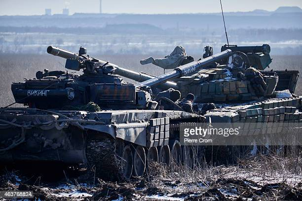 ProRussian rebels tow a seized Ukrainian tank on February 18 near Vuglegirsk Ukraine Ukrainian troops have been forced to retreat from Debaltseve...