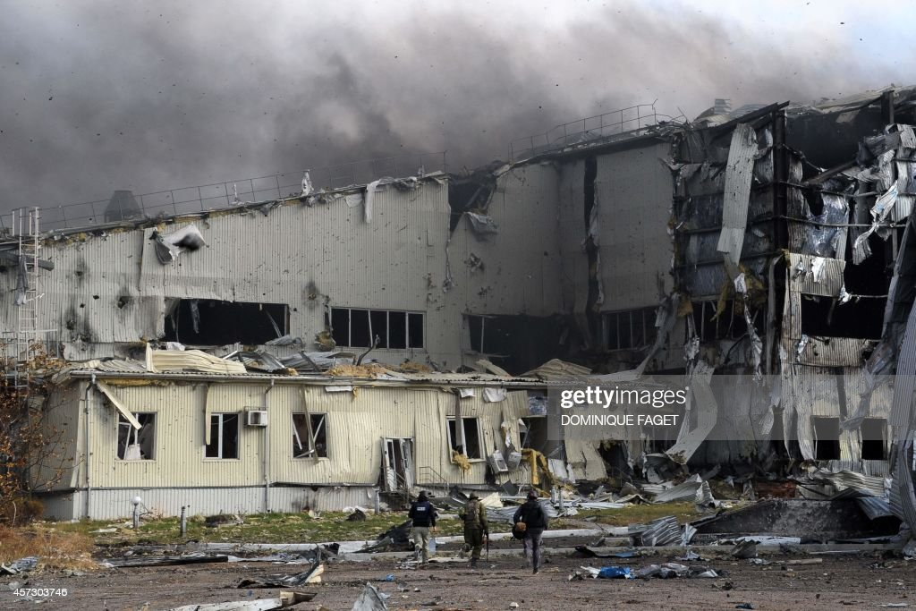 ProRussian separatist fighters and journalists run for cover during shelling of the Donetsk's Sergey Prokofiev international airport as fighting...