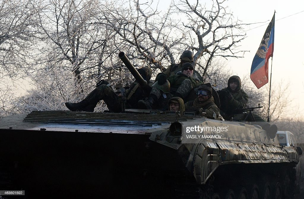 ProRussian separatists ride an Armoured Personnel Carrier bearing the flag of the 'Donetsk People's Republic' near the eastern Ukrainian city of...