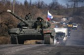 ProRussian separatists ride on top of a tank near the town of Krasnyi Luch in Lugansk region eastern Ukraine on October 28 2014 Russia announced it...