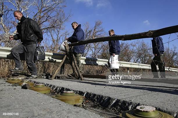 ProRussian separatists walk during an exchange of prisoners near Schastie village in Luhansk eastern Ukraine Thursday Oct 29 2015 Nine Ukrainian...