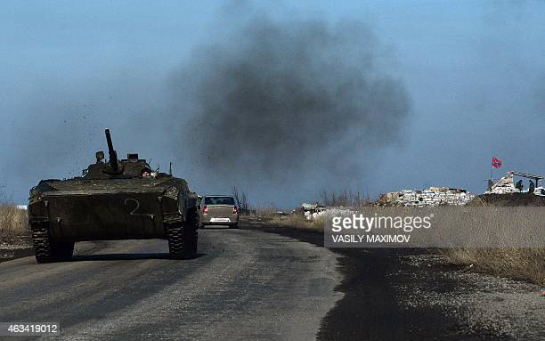 A ProRussian separists' armoured personnel carrier is pictured near eastern Ukrainian city of Yenakievo on February 14 2015 Fighting has raged on in...