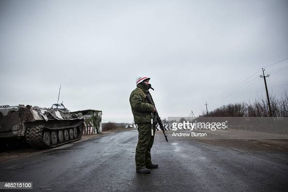 A proRussian seperatist stands guard at a check point on the road heading to Mariupol on March 4 2015 in Novoazovsk Ukraine Novoazovsk lies east of...