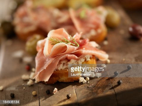 Prosciutto stock photos and pictures getty images for Prosciutto and melon canape