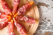 Prosciutto and melon seen from above