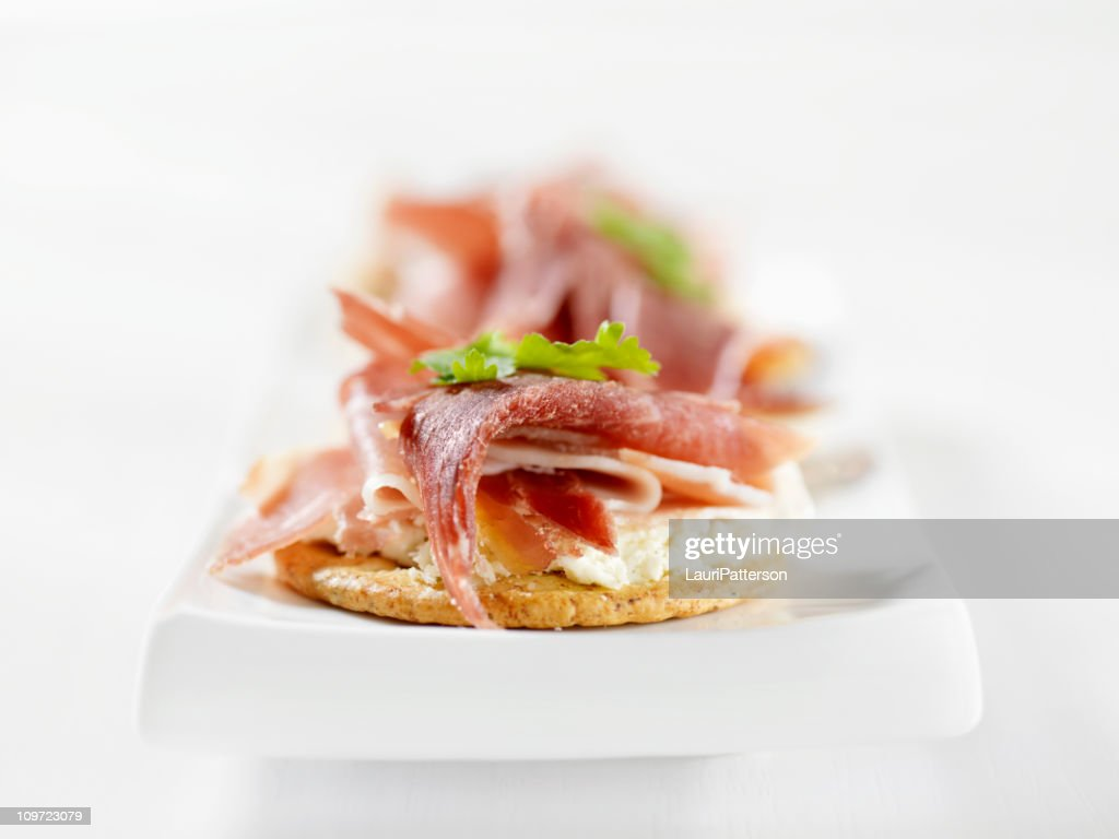 Prosciutto canapes with cream cheese stock photo getty for Cream cheese canape