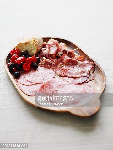 Prosciutto, salami, capicola, kalamata olives, peppers and bread : Stock Photo