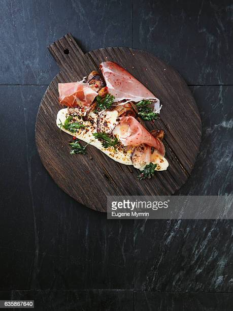 Prosciutto with porcini, cheese and herb