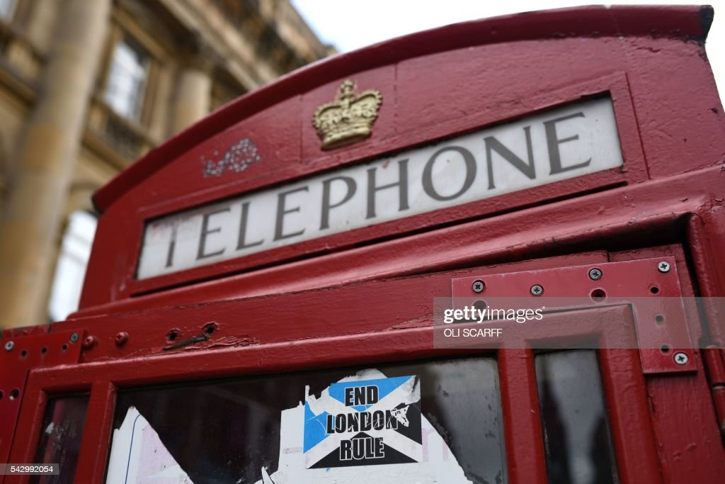 A pro-Scottish independence sticker is pictured on the side of a telephone box in Edinburgh, Scotland on June 25, 2016, following the pro-Brexit result of the UK's EU referendum vote. The result of Britain's June 23 referendum vote to leave the European Union (EU) has pitted parents against children, cities against rural areas, north against south and university graduates against those with fewer qualifications. London, Scotland and Northern Ireland voted to remain in the EU but Wales and large swathes of England, particularly former industrial hubs in the north with many disaffected workers, backed a Brexit. / AFP / OLI
