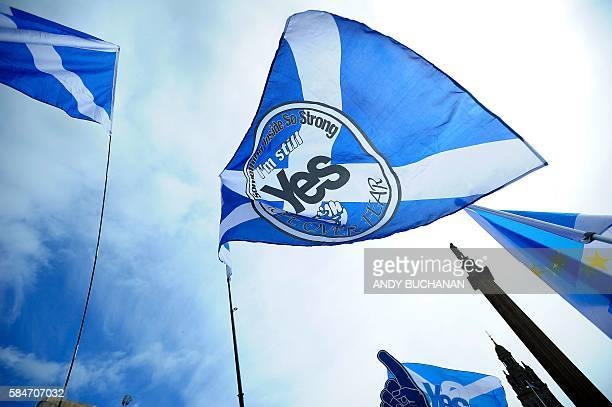 ProScottish Independence supporters with Scottish Saltire flags rally in George Square in Glasgow Scotland on July 30 2016 to call for Scottish...