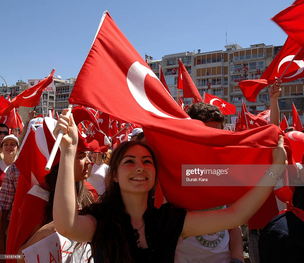 Pro-secular Turks chant slogans as they wave national flags during an anti-government rally May 13, 2007 in Turkey's western coastal city of Izmir. Thousands of secular Turks gathered in the city of Izmir to protest against the Islamist-rooted government in a rally organizers hope will unite the opposition ahead of elections in July.