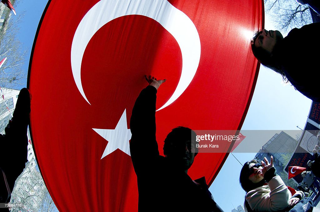 A prosecularist Turk holding his national flag attends a rally against Turkish Prime Minister Tayyip Erdogan's possible candidacy to the presidency...