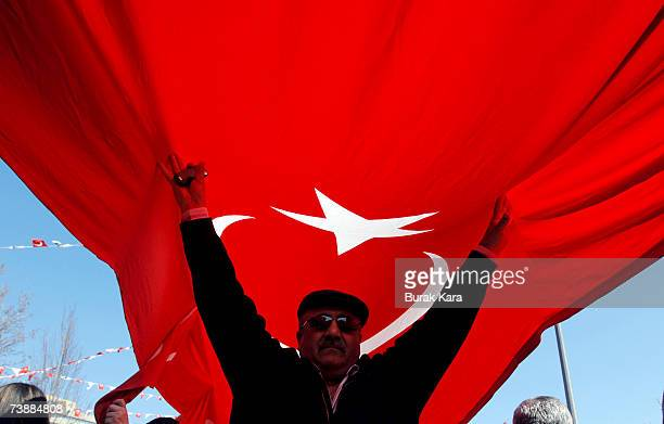 Prosecularist Turks holding their national flag attend a rally against Turkish Prime Minister Tayyip Erdogan's possible candidacy to the presidency...