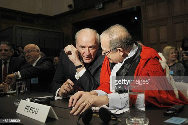 Prosecutor Alain Pellet and ambassador Jose Antonio Garcia Belaunde of Peru talk in the International Court of Justice in The Hague The Netherlands...