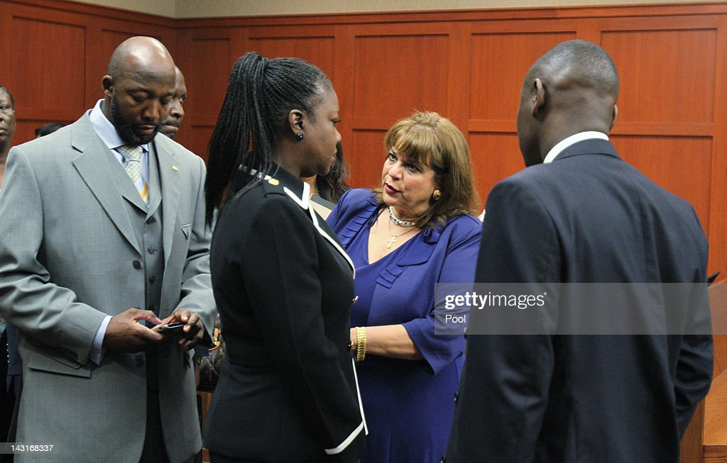 Prosecutor Angela Corey (2nd R) talks with <a gi-track='captionPersonalityLinkClicked' href=/galleries/search?phrase=Tracy+Martin+-+Father+of+Trayvon+Martin&family=editorial&specificpeople=9075765 ng-click='$event.stopPropagation()'>Tracy Martin</a> (L) and <a gi-track='captionPersonalityLinkClicked' href=/galleries/search?phrase=Sybrina+Fulton&family=editorial&specificpeople=9024062 ng-click='$event.stopPropagation()'>Sybrina Fulton</a> (2nd L), parents of Trayvon Martin, and their attorney <a gi-track='captionPersonalityLinkClicked' href=/galleries/search?phrase=Benjamin+Crump+-+Attorney&family=editorial&specificpeople=9042867 ng-click='$event.stopPropagation()'>Benjamin Crump</a> during George Zimmerman's bond hearing on April 20, 2012 in Sanford, Florida. Trayvon Martin was shot by George Zimmerman, a member of a neighborhood watch in Sanford, Florida, who has been charged with second degree murder in the shooting. Bail was set at $150,000 for Zimmerman and he could be released from jail as early as April 21.