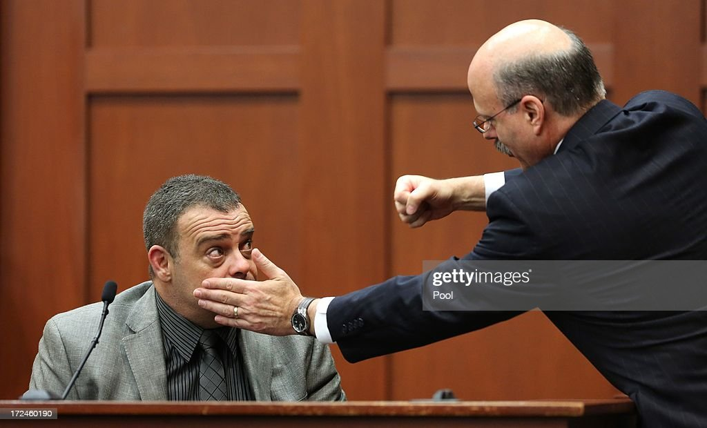 Prosecutor Bernie de la Rionda (R) demonstrates a possible scenario while questioning state witness Chris Serino, a Sanford police officer, during the George Zimmerman trial in Seminole circuit court July 2, 2013 in Sanford, Florida. Zimmerman is charged with second-degree murder for the February 2012 shooting death of 17-year-old Trayvon Martin.