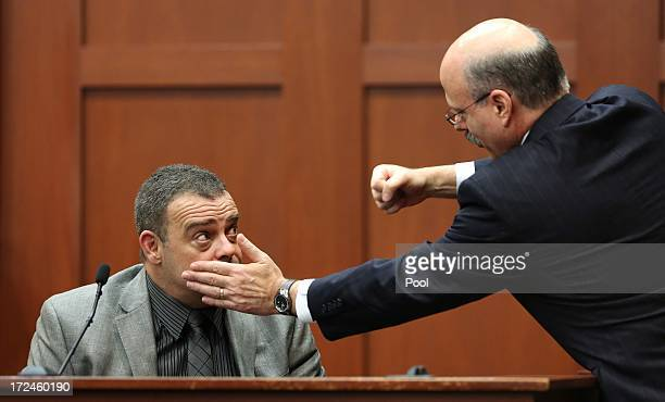 Prosecutor Bernie de la Rionda demonstrates a possible scenario while questioning state witness Chris Serino a Sanford police officer during the...